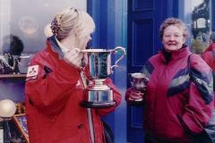 "Would you call mine an ""F"" and yours a double ""A"" cup? - Kath Grindrod with one of the larger trophies"