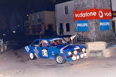"Sixth overall, First in Class C and ""Best Scottish Crew"" award - Willie Bonniwell and Ali Campbell in their Ford Escort Mk2 1998 going round the Clock Tower in Tobermory High Street on Friday Night's Millennium Stage"